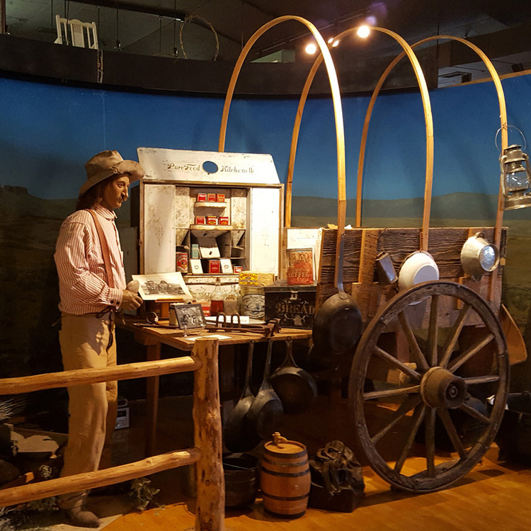 museum display of pioneer and wagon