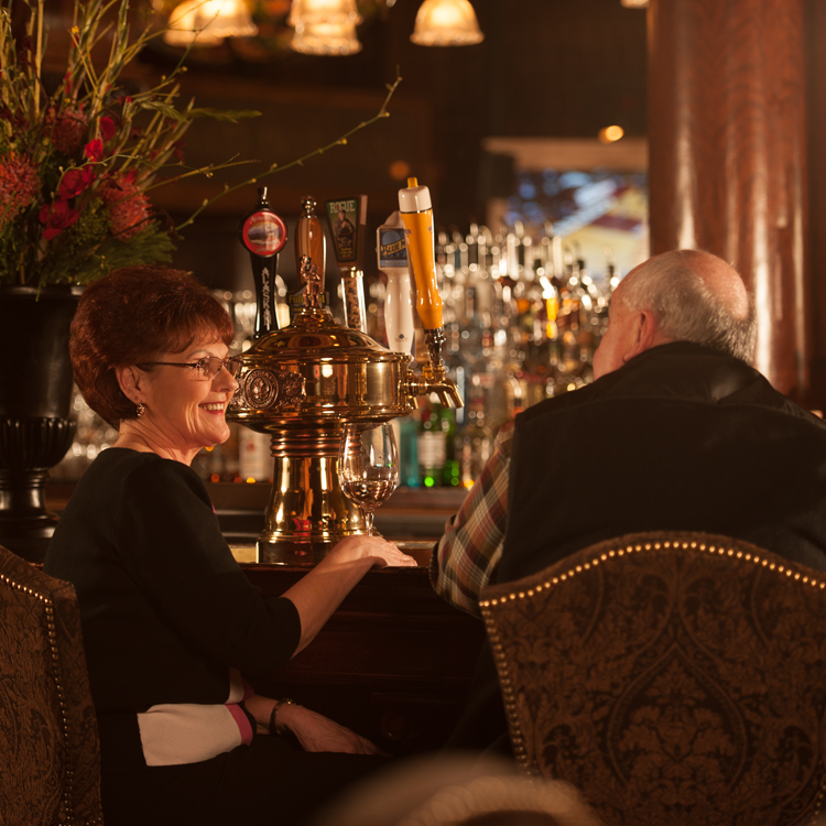 couple sitting at bar