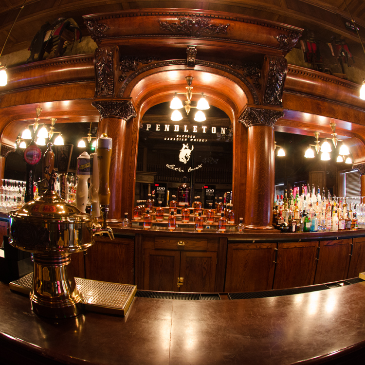 bar with dark wood and mirrors
