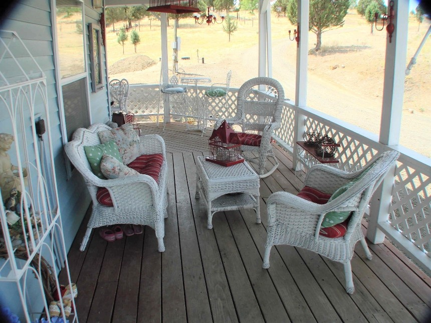 Guests can enjoy the porch at Victorian Lane Bed & Breakfast
