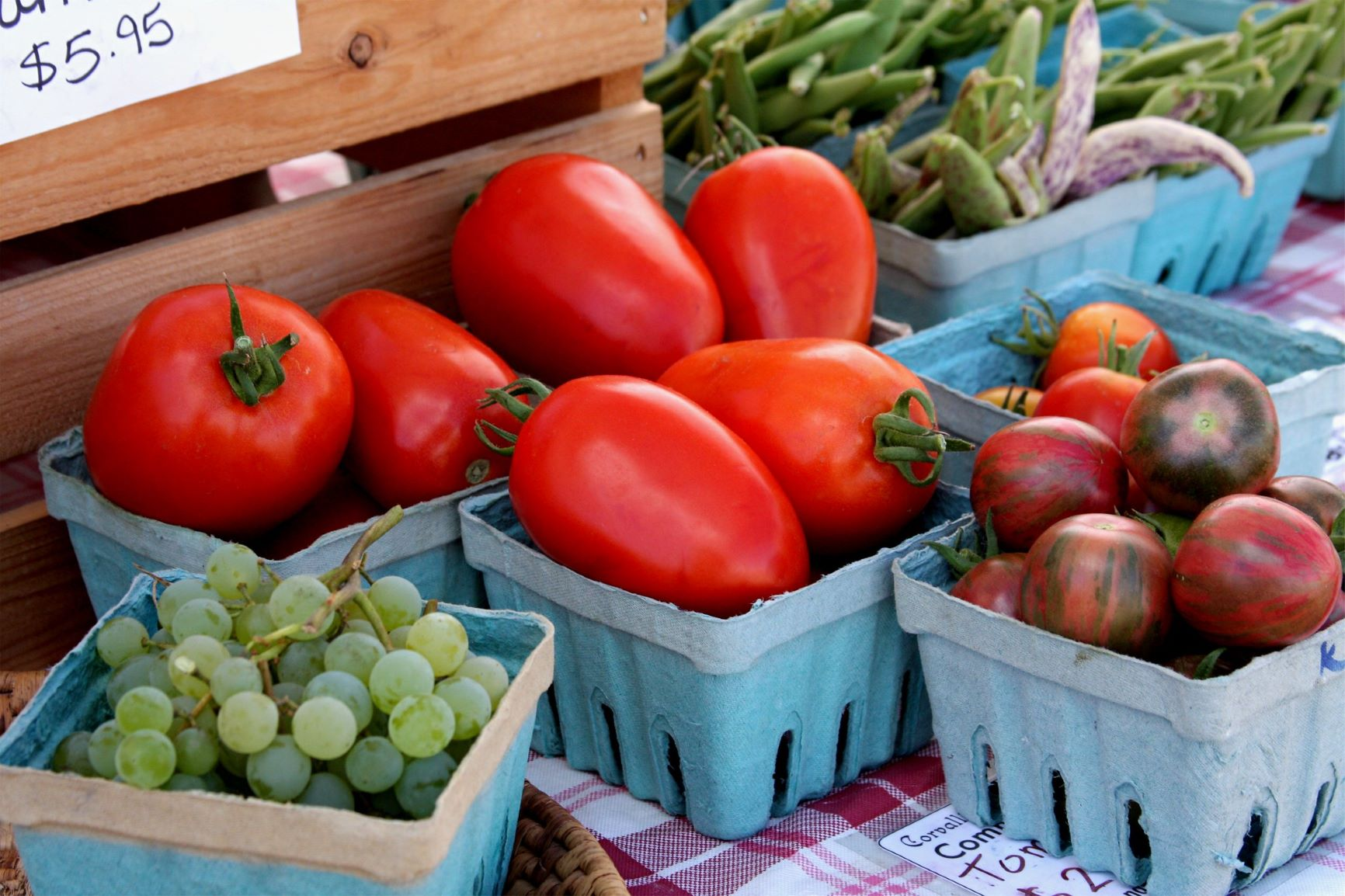 Photo of vegetables and fruit at outdoor market.