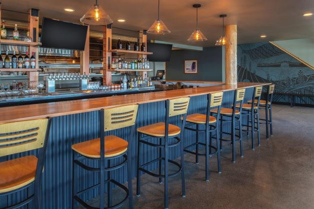bar seating at Two Barrels Taps + Grill
