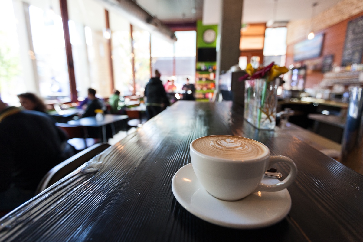 Latte with art sitting on the bar