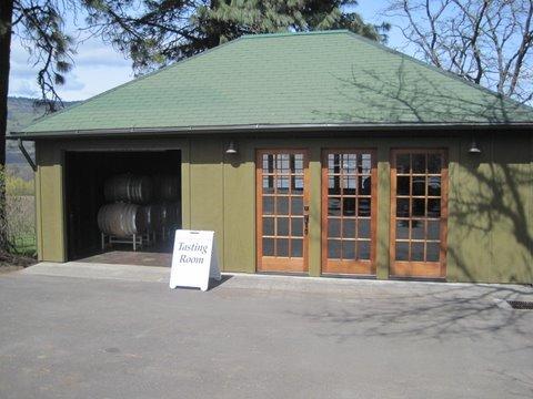 Green tasting room with brown doors