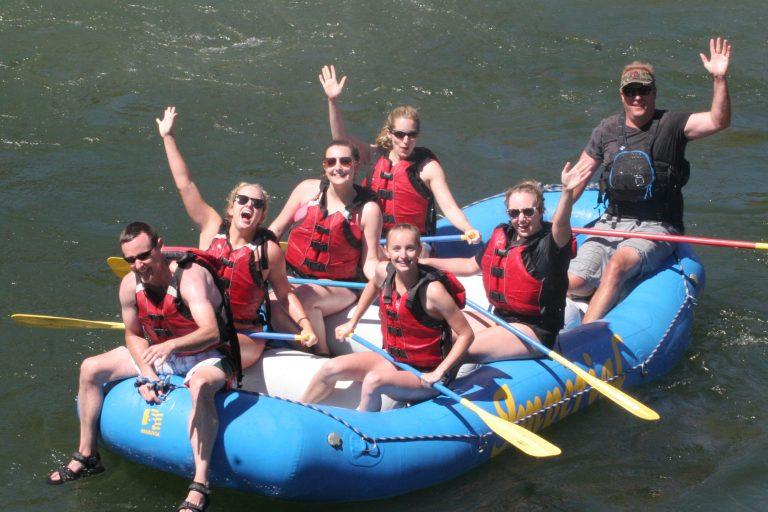 People on a raft waving