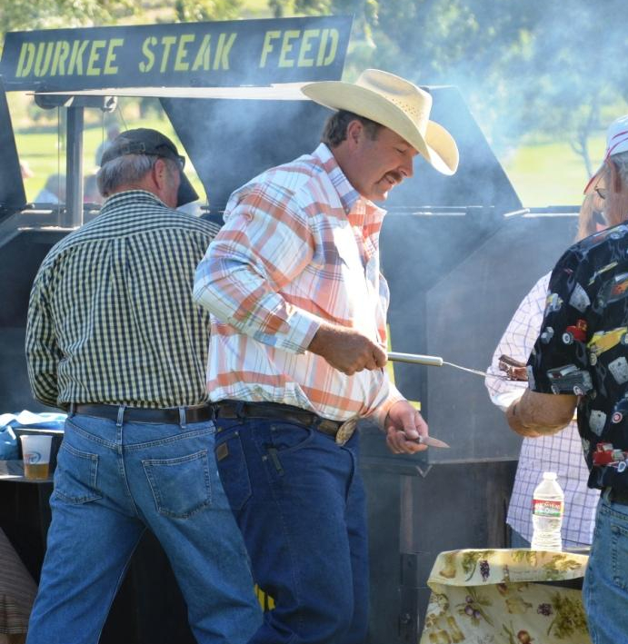 Steaks coming off the grill at the Durkee Steak Feed